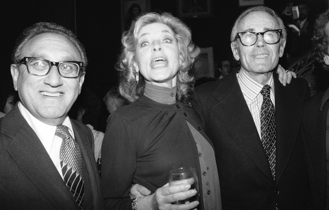 "This June 8, 1979 file photo shows actress Lauren Bacall, center, with Henry Kissinger, left, and actor Henry Fonda at a party to launch her autobiography,""By Myself"" at the Palace Theater in New York."