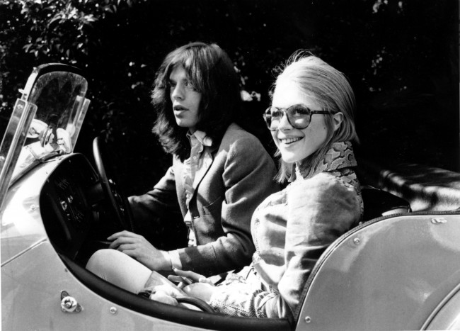 Lead singer of The Rolling Stones Mick Jagger and British pop singer Marianne Faithfull are shown leaving home in Cheyne Walk, Chelsea, England on May 29, 1969. They are driving to their hearing at Marlborough St. Court on charges of drug possession. (AP Photo)