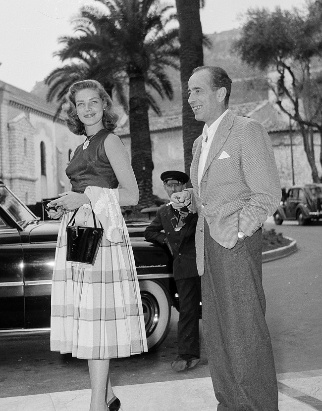 Actress Lauren Bacall, left, and her husband, actor Humphrey Bogart, are shown on a street in Cannes during a few days vacation on the French Riviera, France, on June 26, 1953. (AP Photo)
