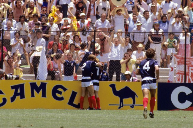 Soccer - World Cup Mexico 1986 - Group E - Scotland v West Germany - La Corregidora Stadium (L-R) Scotland's Richard Gough congratulates teammate Gordon Strachan on scoring the opening goal as Graeme Souness runs to join them Date: 08/06/1986