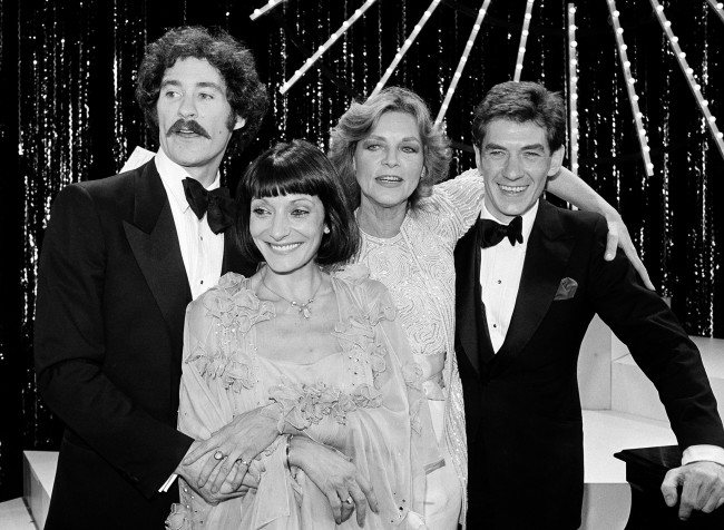 "Four winners pose onstage at the Tony Awards presentation show in New York, June 7, 1981. From left are: Kevin Kline, best actor in a musical for "" Pirates; "" Jane Lapotaire, best actress in a play for "" Piaf; "" Lauren Bacall, best actress in a musical for "" Woman of the Year; ""and Ian McKellen, best actor in a play for ""Amadeus."" (AP Photo)"
