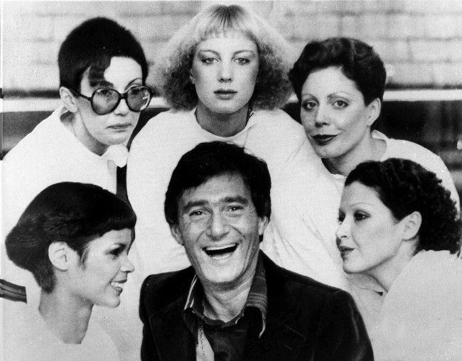 Hairstylist Vidal Sassoon is surrounded by models, showing his new cuts for 1976, in London, on Jan.23, 1976. The styles are called, clockwise from lower left; The Hummingbird, Question Mark, Feathers, Tomboy and Silver Lady. (AP Photo) Ref #: PA.3861982  Date: 23/01/1976