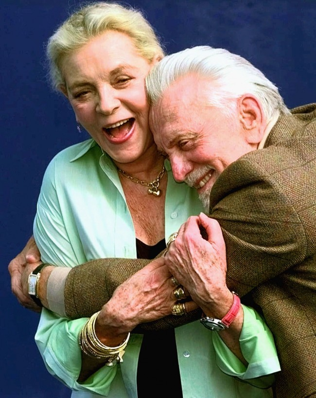 "American movie stars Lauren Bacall and Kirk Douglas hug during a photocall to promote their movie ""Diamonds"" by U.S. director John Asher to be screened at the American Film Festival in Deauville, Normandy, France, Tuesday, Sept. 7, 1999."