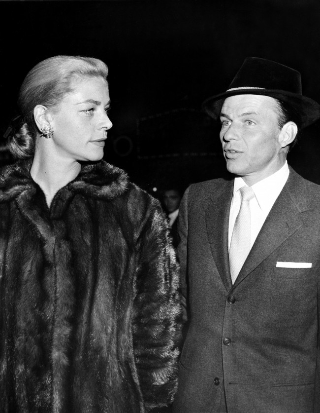 "Frank Sinatra, right, and Lauren Bacall arrive at a film preview of ""Pal Joey"" in Hollywood, Ca., in Nov. 1957."
