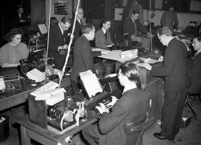 Results come pouring in via tickertape and are quickly typed into news bulletins in the results area of the Press Association's news room, during the evening of the February 1952 General Election. archive-pa17347-6 Ref #: PA.5297511  Date: 24/02/1952