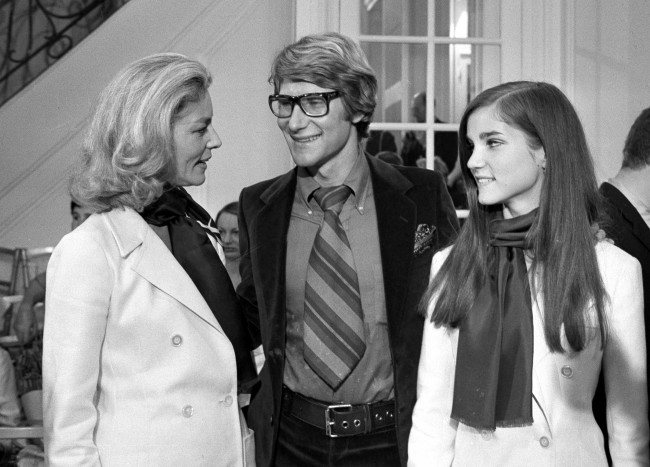 French designer Yves Saint Laurent, center, is congratulated by American actress Lauren Bacall, left, and her daughter Leslie Bogart, after the presentation of Saint Laurent's fashion collection. 1968.