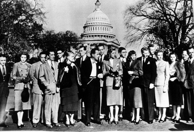 A group of Hollywood stars pose against the Capitol dome as they arrive for a session of the House Un-American Activities Committee in Washington, D.C., Oct. 27, 1947. From left are, Jules Buell, Marsha Hunt, David Hopkins, Richard Conte, Ralph Alswang, June Havoc, John Huston, Sterling Hayden, back, Humphrey Bogart, Paul Henreid, Lauren Bacall, Joseph Sistrom, Evelyn Keyes, Danny Kaye, Sheppard Strudwick, Jane Wyatt, Geraldine Brooks, Ira Gershwin and Larry Adler. (AP Photo)