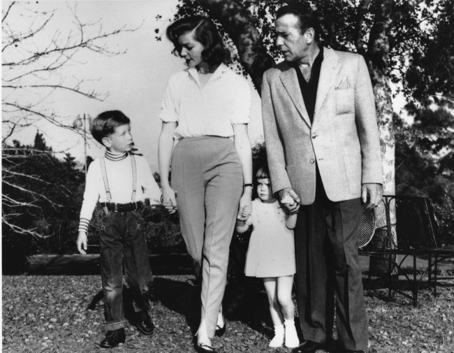 Actor Humphrey Bogart and his wife, actress Lauren Bacall, and their children Stephen, 6, and Leslie, 2, walk on the grounds at their home in Hollywood, Calif., on April 19, 1955
