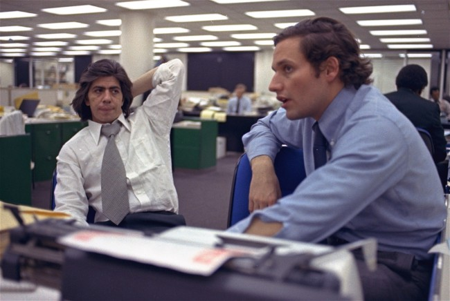 Reporters Bob Woodward, right, and Carl Bernstein, whose reporting of the Watergate case won a Pulitzer Prize, sit in the newsroom of the Washington Post, May 7, 1973. (AP Photo)