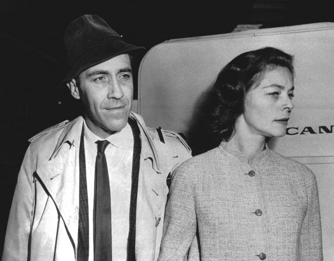 Jason Robards and Lauren Bacall are shown at New York's Idlewilde Airport in a May 8, 1961, photo. (AP Photo)
