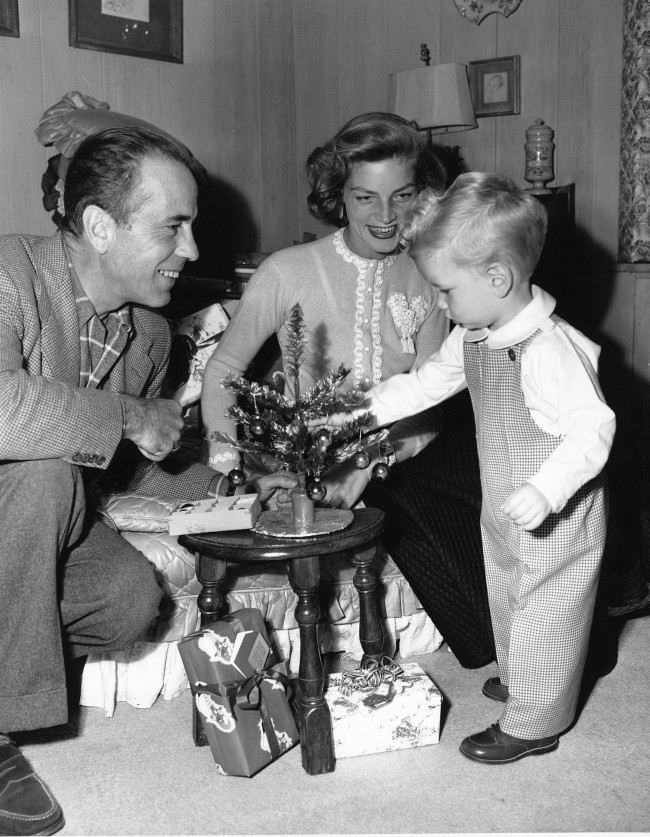 Actor Humphrey Bogart and his wife, actress Lauren Bacall, help their son Stephen decorate a small Christmas tree in their home in Hollywood, Calif., on Dec. 20, 1950.