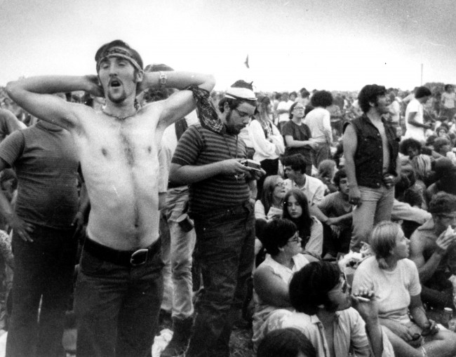 Rock music fans relax during a break in the entertainment at the Woodstock Music and Arts Fair in Bethel, N.Y., on Aug. 16, 1969. (AP Photo)
