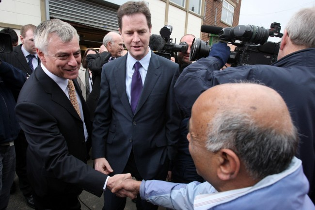 Liberal Democrat Party Leader Nick Clegg (centre), and PPC David Ward meet members of the public during a visit to Printing Roller Services in Bradford, Yorkshire.