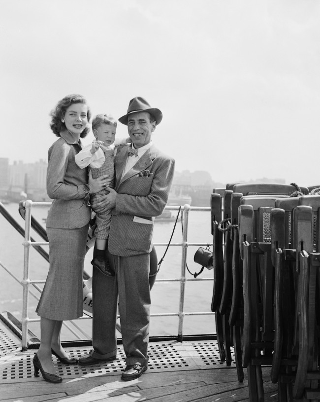 Humphrey Bogart, his actress wife, Lauren Bacall, and their son, Stephen, aged two, gather on a deck of the French liner Ile De France on Sept. 13, 1951 in New York City, following their arrival from Europe.