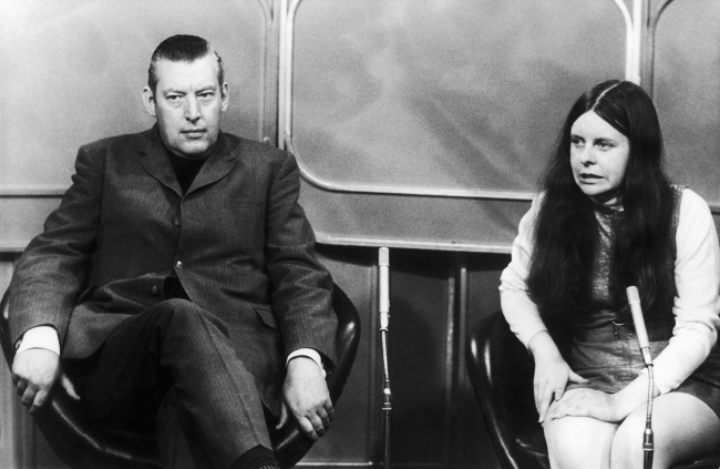 Bernadette Devlin Member of Parliament for Mid-Ulster and the reverend ian Paisley, Member of Parliament for North Antrim, wait to take part in a TV programme in the Thames Studios, London, on Sept. 22, 1971. (AP Photo)
