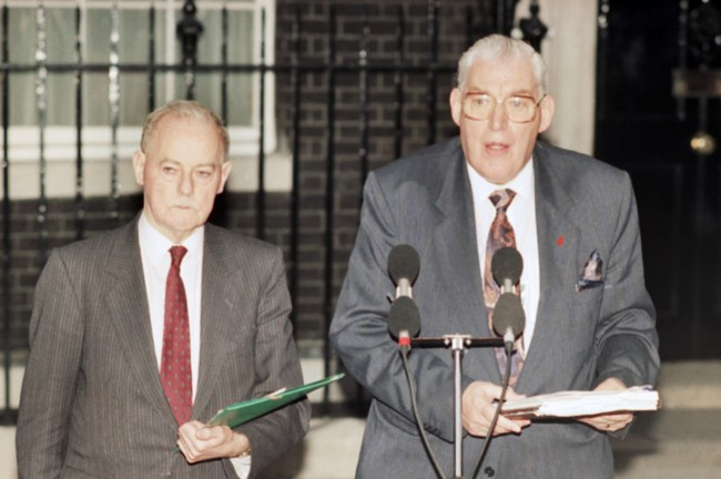 James Molyneaux, leader of the Ulster Unionist Party, left, and Reverend Ian Paisley, leader of the Democratic Unionist Party speak to reporters outside No. 10, Downing Street, in London, on May 15, 1991, after talks with British Prime Minister John Major and Peter Brooke. The talks ended without agreement. (AP Photo/Gill Allen)