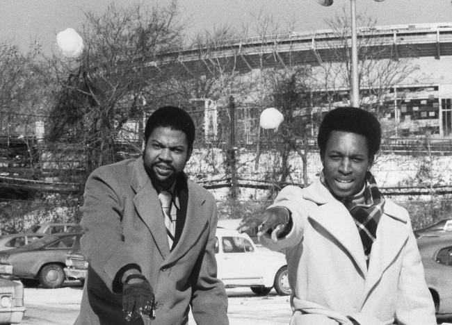 Pitcher Dock Ellis, left, and second baseman Willie Randolph limber up with snowballs outside New York's Shea Stadium, Feb. 3, 1976. Both players signed 1976 Yankee contracts today. (AP Photo)
