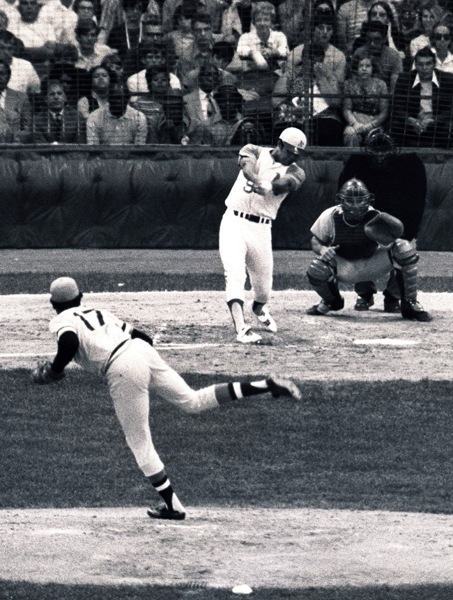 In this file photo made July 13, 1971, American League All-Star pinch hitter Reggie Jackson, of the Oakland Athletics, hits a two-run home run in the third inning against the National League in Detroit. National League pitcher Dock Ellis (17), of the Pittsburgh Pirates, and catcher Johnny Bench, of the Cincinnati Reds, look on. (AP Photo, File)