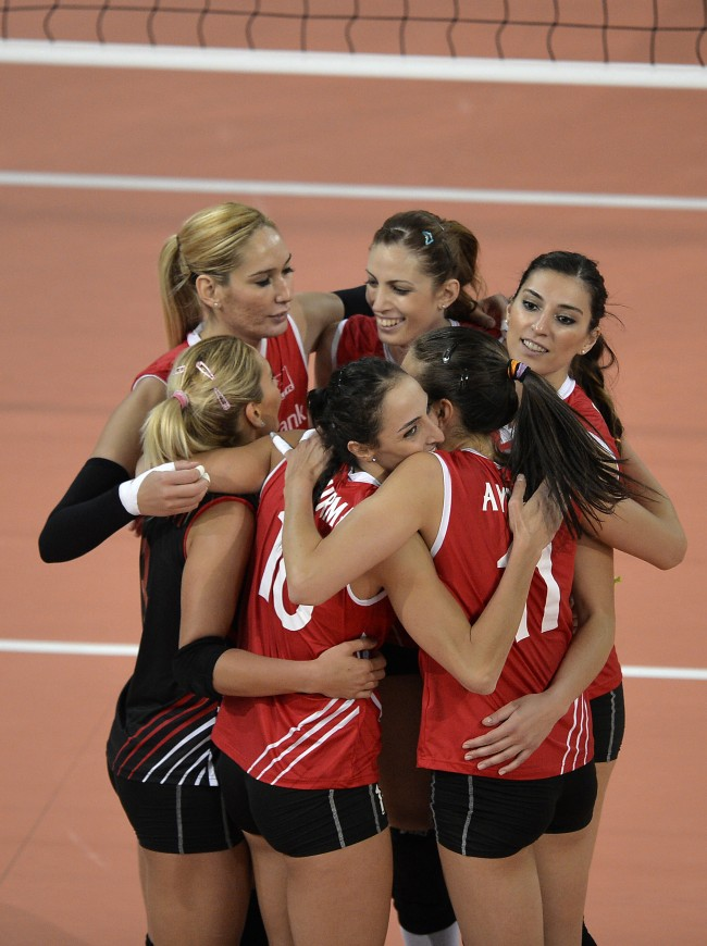 Turkey's players celebrate after winning the Women's Volleyball European Championship Playoff match between Turkey and Belarus in Halle in Westfalen, Germany, Tuesday, Sept. 10, 2013. Turkey defeated Belarus with 25-16, 25-13 and 25-17. (AP Photo/Martin Meissner)
