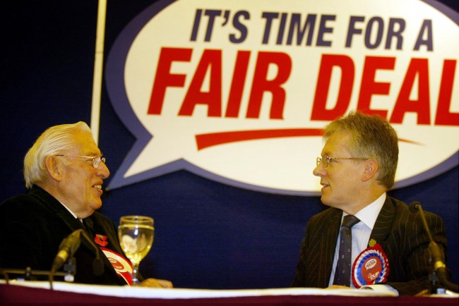 Rev Ian Paisley (left), leader of the Democratic Unionist Party (DUP), with the deputy leader Peter Robinson during the launch of the Party manifesto in Belfast. All parties aspiring to be part of the government of Northern Ireland must turn their backs on violence for good, the DUP insisted today in a glossy 32-page Assembly Election manifesto.  Ref #: PA.1830154  Date: 11/11/2003