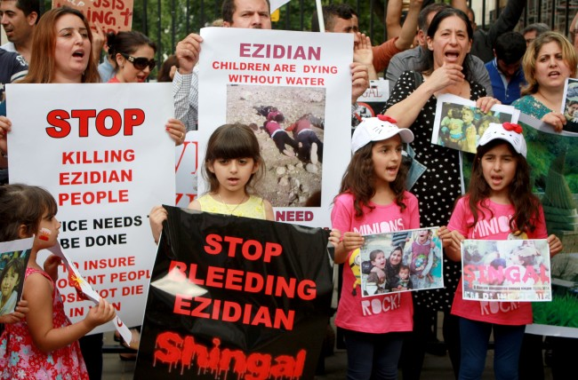 Protesters on Whitehall, London, who are calling for help from the government for the Yazidi religious minority who have been forced to flee after attacks by Islamic State extremists in northern Iraq. Picture date: Friday August 8, 2014.