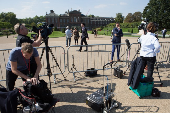 V crews set up their cameras in front of Kensington Palace, London, the official residence of the Duke and Duchess of Cambridge after the announcement that the Duchess is expecting their second child.