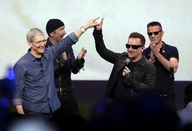 "FILE - In this Sept. 9, 2014 file photo, Apple CEO Tim Cook, left, greets Bono from the band U2 after they preformed at the end of the Apple event on Tuesday, Sept. 9, 2014, in Cupertino, Calif. Apple unveiled a new Apple Watch, the iPhone 6 and Apple Pay and U2 offered iTunes customers a free download of their latest album, ""Songs of Innocence."" (AP Photo/Marcio Jose Sanchez)"