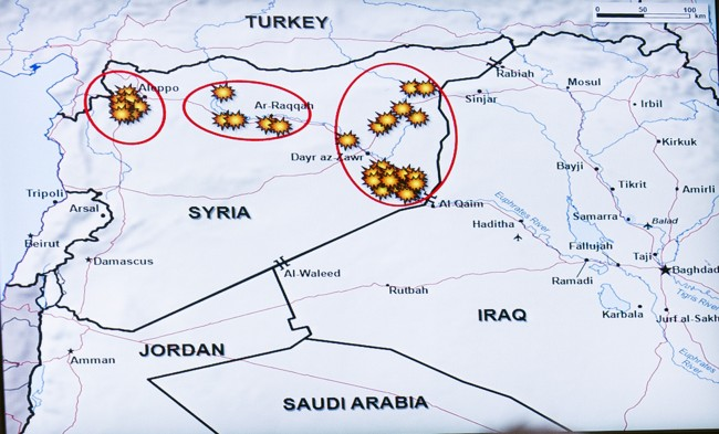 The airstrike map shown by Army Lt. Gen. William Mayville, Jr., Director of Operations J3, as he briefs the news media on operations in Syria, at the Pentagon in Arlington, Va., Tuesday, Sept. 23, 2014. (AP Photo/Cliff Owen) Date: 23/09/2014