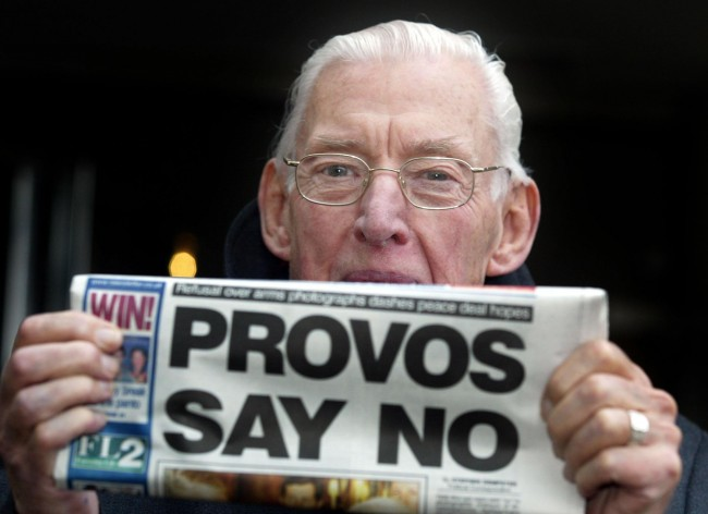 Ian Paisley leader of the Democratic Unionist Party, with a Belfast paper, after meeting with the General John De Chastelain, head of the International Decommissioning body. Ref #: PA.2149881  Date: 08/12/2004