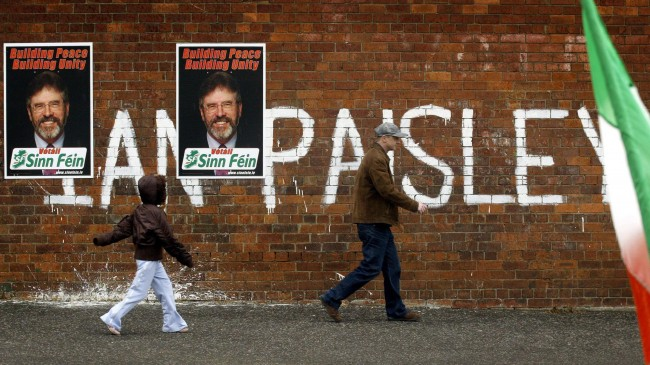 Sinn Fein election posters of Gerry Adams placed on top of graffiti supporting Democratic Unionist party leader Ian Paisley in West Belfast. Ref #: PA.2389153  Date: 05/05/2005