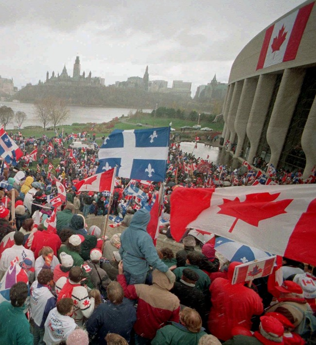 Thousands of supporters for national unity gather at the Museum of Civilization in Hull, Quebec, across the Ottawa river from Parliament Hill, Sunday October 29, 1995. The two sides in Quebec's bloodless but bitter war of secession made emotional final appeals Sunday to the undeclared voters who will cast the crucial ballots in the vote on splitting from Canada.(AP PHOTO/Fred Chartrand)