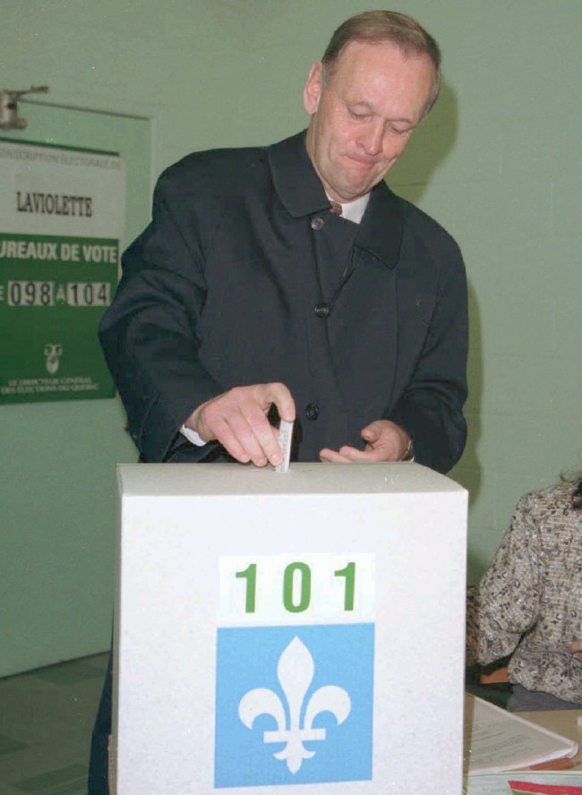 Canadian Prime Minister Jean Chretien, a Quebecker committed to keeping Canada intact, casts his ballot Monday Oct. 30,1995, in St. Flore, Quebec, to vote in the referendum on Quebec's secession. Canada's destiny was at stake Monday as 5 million Quebec voters decide whether their province--with one-fourth of the country's people and one-sixth of its land --should break away to form an independent nation.(AP Photo/CP,Jacques Boissinot)