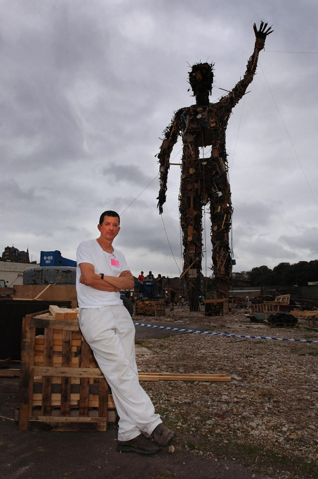 Sculptor Antony Gormley stands in front of his 25 metre high 'Waste Man', a giant sculpture made out of waste wood, paper and cardboard, at Dreamland, Margate. Picture date: Thursday September 28, 2006.