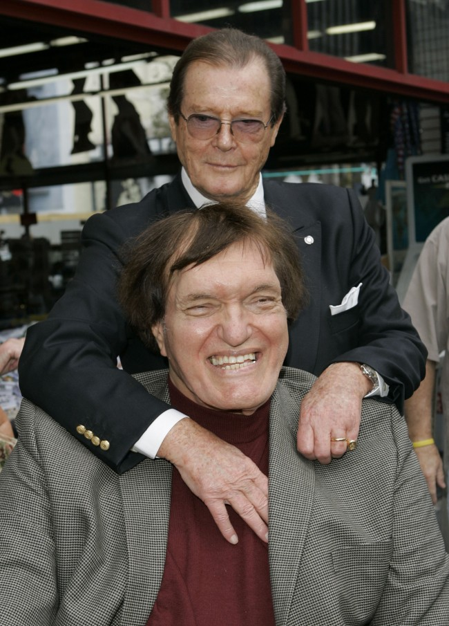 "Actor Roger Moore, seen in background, who played the part of James Bond 007 in seven films, poses with actor Richard Kiel who played the role of Jaws in ""The Spy Who Loved Me,"" during a ceremony honoring Moore with a star on the Hollywood Walk of Fame, Thursday, Oct. 11, 2007, in the Hollywood section of Los Angeles. Moore's star is aptly located at 7007 Hollywood Blvd. (AP Photo/Mark J. Terrill)"