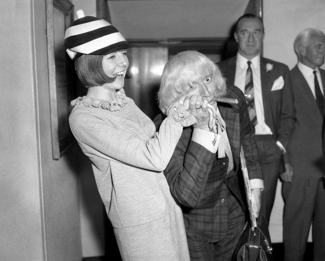 Cilla Black and Jimmy Saville before a Variety Club Luncheon at the Savoy Hotel. Date: 10/08/1964