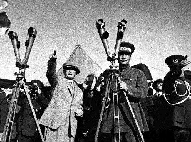 President of Turkey Kemal Ataturk, left, points out somthing of interest to the Shah of Persia, Reza Shah Pahlavi, during military manoeuvres in Turkey, July 3, 1934.(AP Photo)