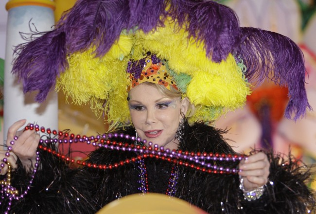 Joan Rivers looks at beads during the Krewe of Orpheus parade in the Uptown area of New Orleans Monday, Feb. 23, 2009. (AP Photo/Alex Brandon)