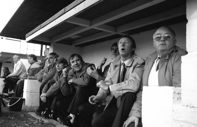 Manchester United manager Alex Ferguson (second r) watches his new team for the first time as they crash to a 2-0 defeat to Oxford United.  Date: 08/11/1986