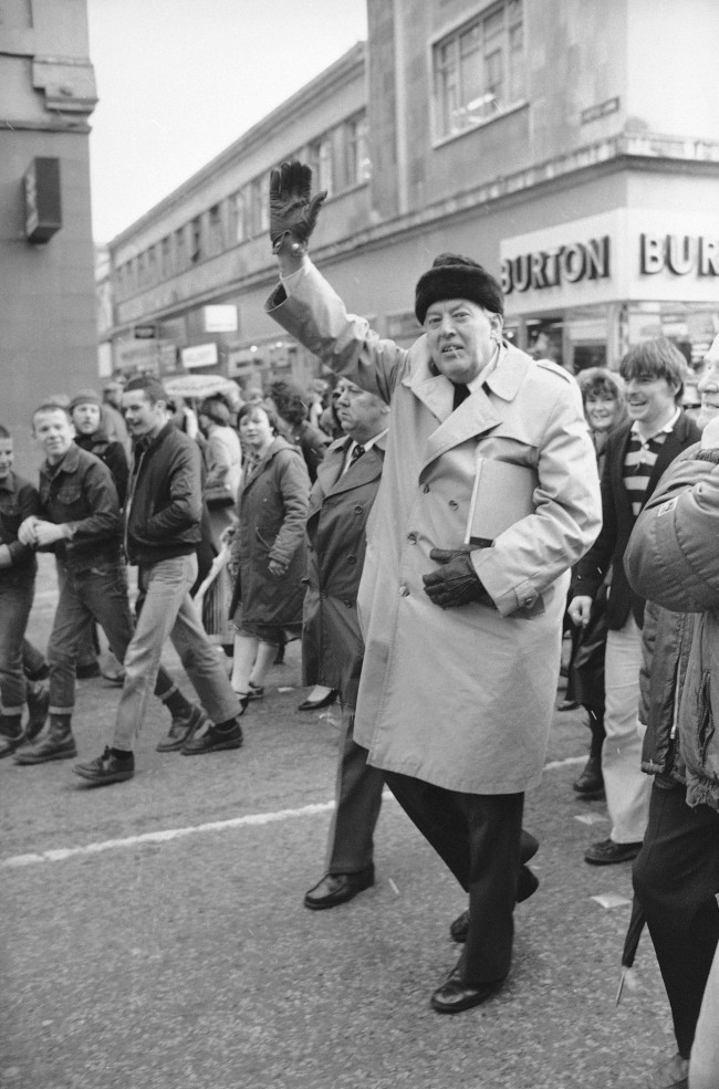 Rev. Ian Paisley waves in triumph as he walks with Loyalists down Royal Avenue in Belfast, Ireland, Nov. 23, 1981. (AP Photo/Peter Kemp)
