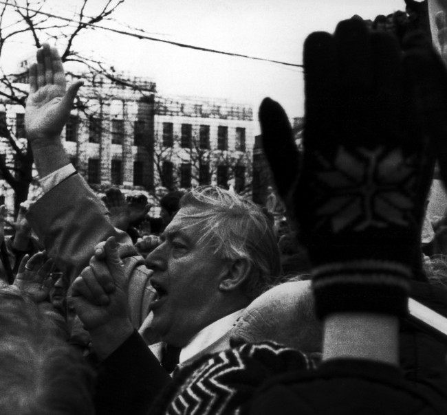 Rev. Ian Paisley gets a show of hands in support of his call for the Protestant Day of Action in Belfast,Northern Ireland, Nov. 23, 1981. Rev. Paisley was addressing a rally of Loyalists outside the City Hall in Belfast this afternoon. (AP Photo/Peter Kemp)