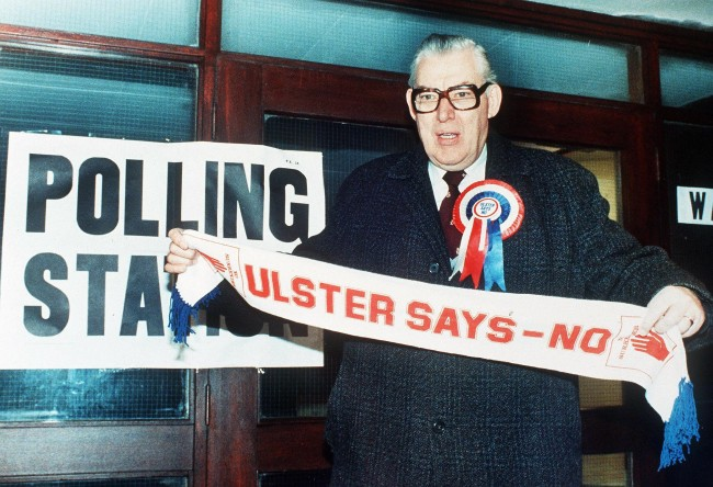 Northern Ireland's DUP leader Reverend Ian Paisley displays a scarf bearing the party slogan Ref #: PA.8662132  Date: 23/01/1986