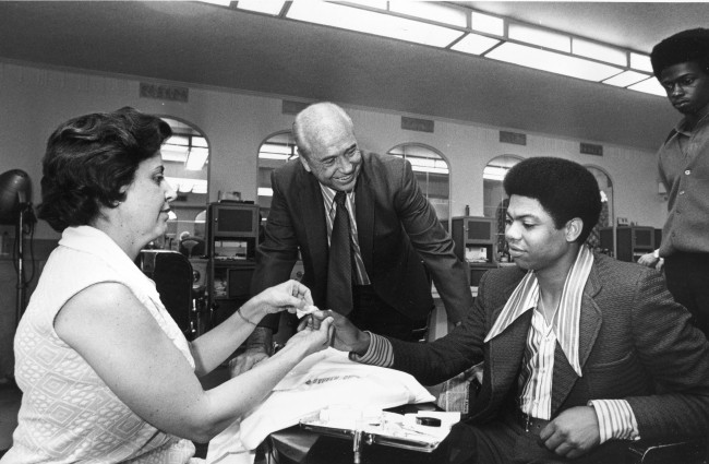 Pittsburgh Pirates pitcher Dock Ellis, right, gets a manicure in a Detroit barbershop, Tuesday morning, July 13, 1971. Ellis is the starting pitcher for the National League in tonight's All-Star game with the American League.