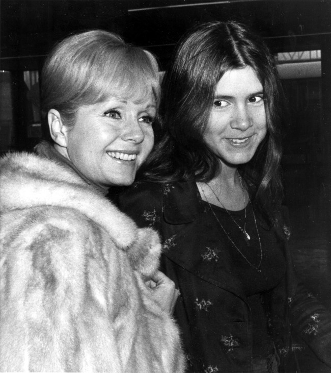 Actress Debbie Reynolds, left, and her daughter Carrie Fisher, 15, are en route to Madrid at Heathrow Airport in London, England, Feb. 12, 1972. (AP Photo)
