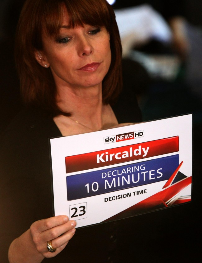 Sky News presenter Kay Burley reads from a card with the wrong spelling of Kirkcaldy written on the back, at the Adam Smith College - where the count for Gordon Brown's Kirkcaldy and Cowdenbeath Constituency was held in the General Election. Picture date: Friday, May 7, 2010.