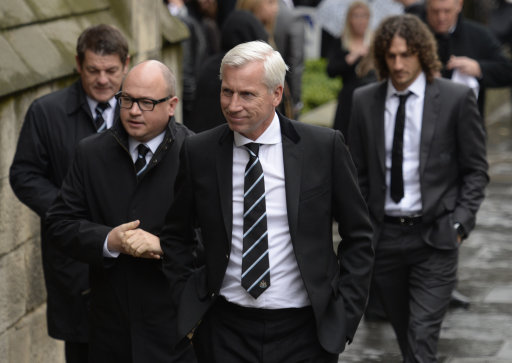 (From the left) Newcastle United assistant manager John Carver, Newcastle United managing director Lee Charnley and manager Alan Pardew, followed by club captain Fabricio Coloccini (right), as they arrive for the funeral of Flight MH17 victim Liam Sweeney at St Mary's Cathedral, Newcastle.