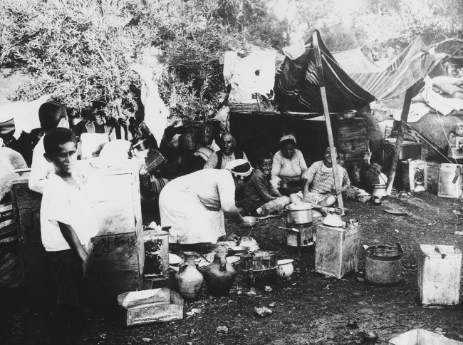 Thousands of Armenian refugees have poured into Syria from the Sanjak of Alexandretta as the Turkish troops occupied the last border strip of the area ceded to them by the French. With them also were several hundred Turkish opponents of the present government in Ankara. Some of the refugees actually set fire to their homes rather than let them fall into Turkish Hands. Armenian refugees in a temporary encampment in Syria after their flight, on August 2, 1939. (AP Photo)