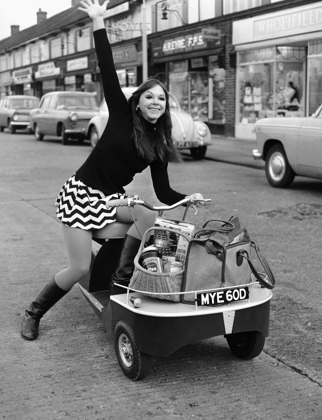 American dancer Felicity 'Flick' Colby with a new battery-powered mini-shopper, in Sidcup, Kent, on Dec. 15, 1966. (AP Photo) Ref #: PA.10871986  Date: 15/12/1966
