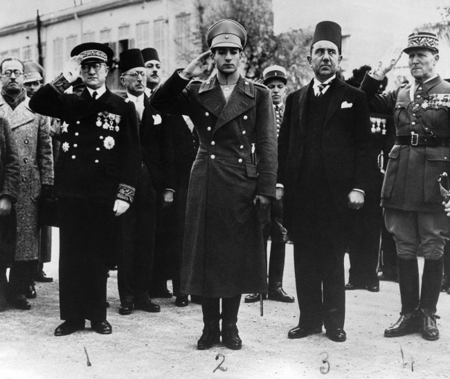 Shahpur Mohammed Riza, Crown Prince of Iran, has now arrived in Cairo for his wedding to Princess Fawzia, sister of King Farouk of Egypt. He boarded the Egyptian Royal Yacht Mahroussa at Beirut, Syria, and with an Escort of Egyptian naval craft, left for Alexandria. Shahpur Mohammed Riza, Crown Prince of Iran, left, acknowledging the welcome of the crowd when he passed through Damascus, on his journey to Cairo on March 5, 1939. With the Crown Prince is the Syrian Minister of Finance and War. (AP Photo)