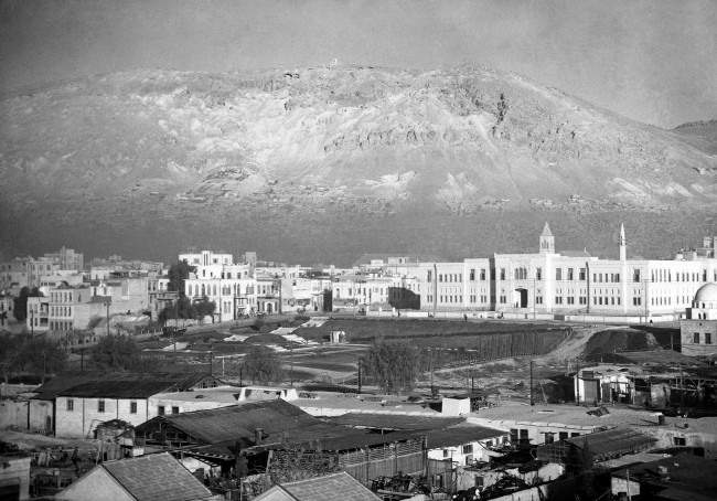 A view of Damascus, Syria, oldest city in the world, with towering hills in background, in December 1938. (AP Photo)
