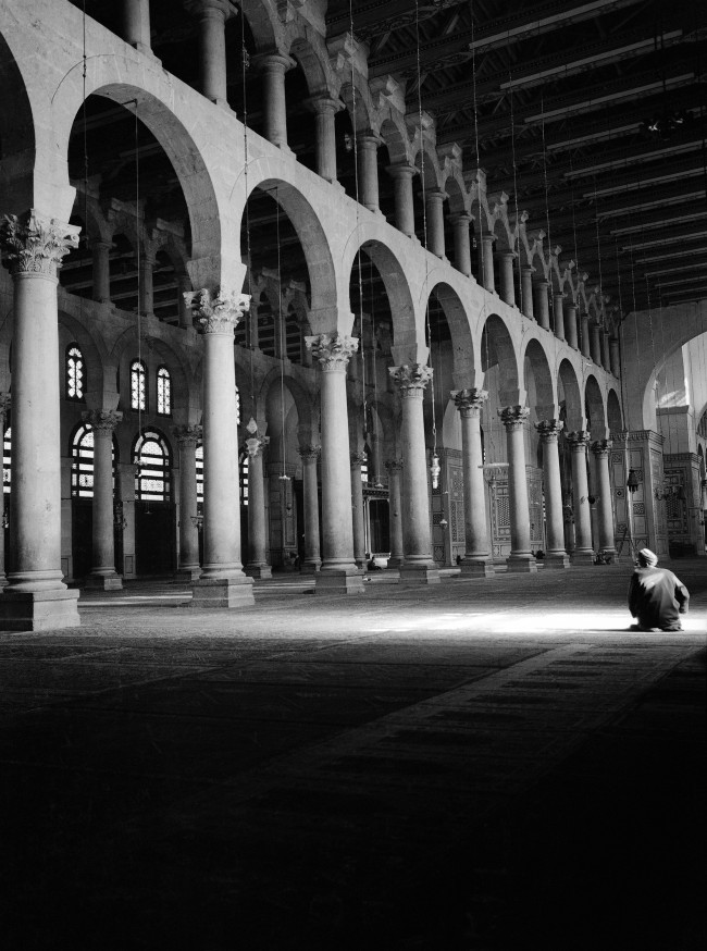 A scene in the famous Mosque of Omey-yade, Damascus, Syria, in December 1938. This famous Mohammedan Shrine ranks with the Mosques at Mecca, Medina and Jerusalem. It also-commemorates the beheading of John the Baptist whose head is supposed to repose in the premises. (AP Photo)